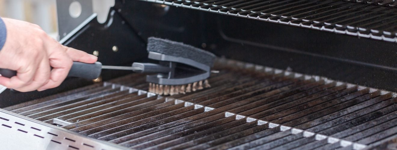 Cleaning a Gas Grill with a Brush