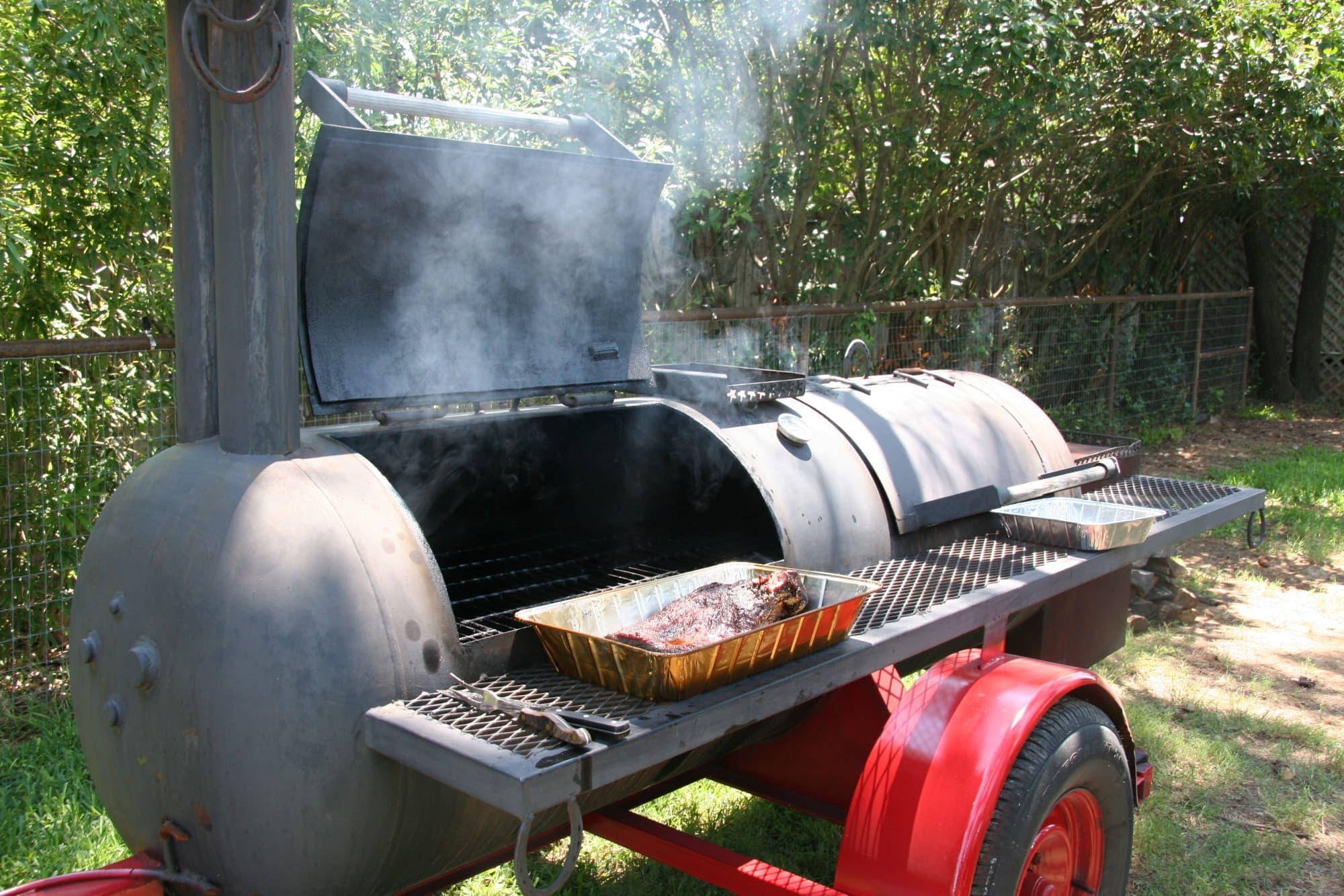 Big BBQ smoker with ribs